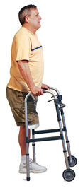 Man with amputated leg standing in center of walker, hands on grips.