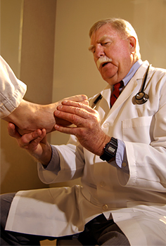 Doctor examining patient's foot.