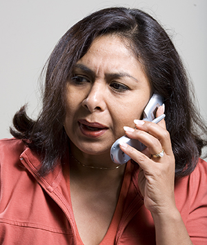 Woman talking on phone.